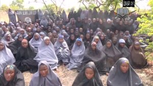 Kidnapped schoolgirls are seen at an unknown location in this still image taken from an undated video released by Nigerian Islamist rebel group Boko Haram. About 100 girls wearing full veils and praying are shown in an undisclosed location in the 17-minute video in which Boko Haram leader Abubakar Shekau speaks. MANDATORY CREDIT. REUTERS/Boko Haram handout via Reuters TV (CONFLICT POLITICS CRIME LAW) ATTENTION EDITORS - THIS PICTURE WAS PROVIDED BY A THIRD PARTY. REUTERS IS UNABLE TO INDEPENDENTLY VERIFY THE AUTHENTICITY, CONTENT, LOCATION OR DATE OF THIS IMAGE. FOR EDITORIAL USE ONLY. NOT FOR SALE FOR MARKETING OR ADVERTISING CAMPAIGNS. NO SALES. NO ARCHIVES. THIS PICTURE IS DISTRIBUTED EXACTLY AS RECEIVED BY REUTERS, AS A SERVICE TO CLIENTS. MANDATORY CREDIT. NO COMMERCIAL USE